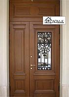 Металлические двери двухстворчатые с ковкой и стеклом