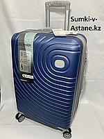 """Средний пластиковый дорожный чемодан на 4-х колесах""""DELONG"""".Высота 67 см, ширина 42 см, глубина 26 см., фото 1"""