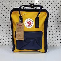 Рюкзак Fjallraven Kanken Classic. Цвет темно синий и желтый отличный вариант для повседневных прогулок
