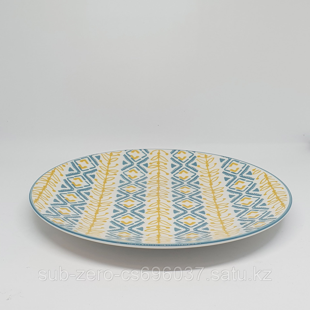 Тарелка желтая с узорами