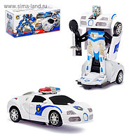 """Машина """"Коп"""", трансформируется, световые и звуковые эффекты, работает от батареек"""