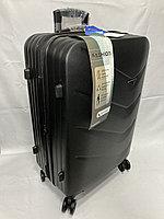 """Средний пластиковый дорожный чемодан на 4-х колесах""""DELONG"""". Высота 67 см, ширина 42 см, глубина 26 см., фото 1"""
