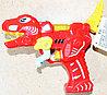 2208 Динозавр пистолет муз на бат 2цвета,8шт в уп.,цена за 1шт 18*11см