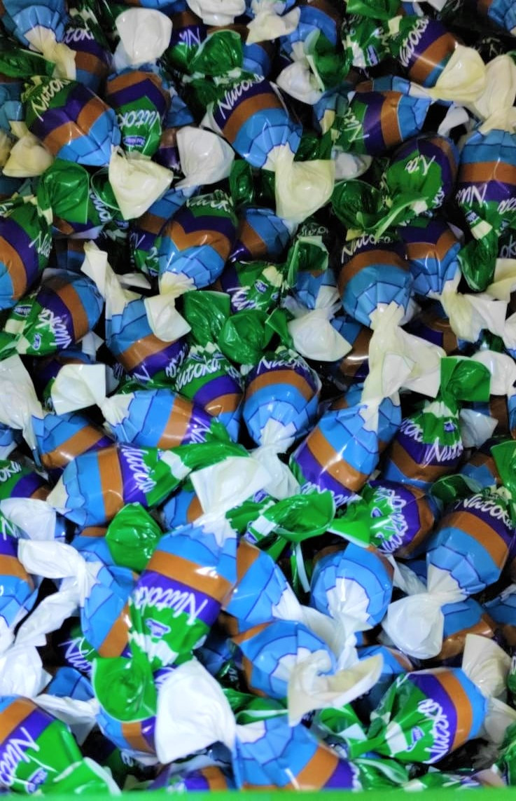 Шоколадные конфеты молочный крем с колотым орехом 1кг