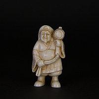 Нэцкэ «Дайкоку» - один из семи богов счастья. Божество богатства и достатка.