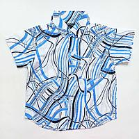 Рубашка белая в черно-голубые разводы (100)
