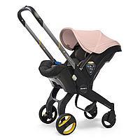 Автокресло-коляска Doona 0+ цвет Blush pink