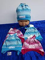 Шапочка трикотажная с завязками для девочки. Фирма Tomar (Maja)