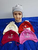 Шапка трикотажная на завязках для девочки. Фирма Tomino (Maja)