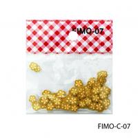 FIMO-C-07Фигурки FIMO в форме темно-желтых цветочков.