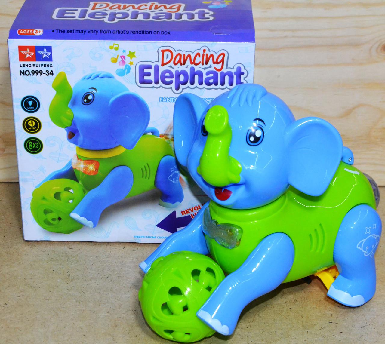 999-34 Слоник Dancing Elephant катает шарик муз 3D на батарейках 18*17