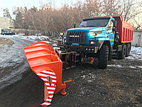 Snow removal truck. Russian dump truck with blade and sand spreader