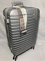 """Средний пластиковый дорожный чемодан на 4-х колесах""""DELONG"""". Высота 67 см, ширина 41 см, глубина 25 см., фото 1"""