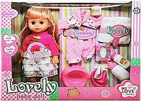 """Кукла музыкальная в платье с одеждой и бутылочками """"Lovely Baby Doll"""".46*37*10 см"""