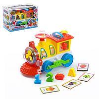 Музыкальная развивающая игрушка с сортером 'Паровоз', световые и звуковые эффекты