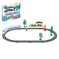 Железная дорога 'Электропоезд', работает от батареек, в комплекте деревья, знаки и станция