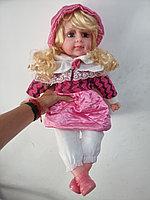 Кукла мягкая музыкальная в куртке.Рост 52 см