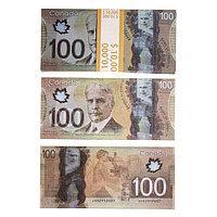 Пачка купюр 100 канадских долларов