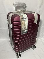 """Маленький пластиковый дорожный чемодан на 4-х колесах"""" DELONG"""". Высота 56 см, ширина 35 см, глубина 22 см."""