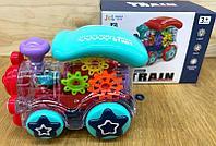0715 Gear Wheel Train Паровозик прозрачный на батар,муз,свет.движение 17*13см