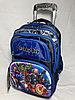 Школьный рюкзак на колесах для мальчика с 1-го по 3-й класс. Высота 47 см, длина 27см,ширина 20 см.