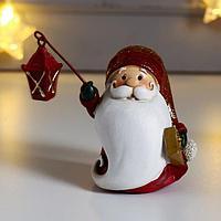 Сувенир полистоун 'Дед Мороз в красной шубе, с фонариком и подарком' 9,5х6х9 см (комплект из 4 шт.)