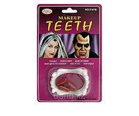 Зубы вампира и кровь в капсулах для грима