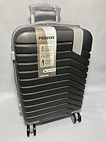 """Маленький пластиковый дорожный чемодан на 4-х колесах """"DELONG"""". Высота 56 см, ширина 35 см, глубина 22 см."""