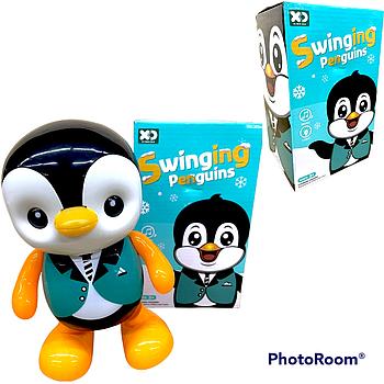 17178 Swiging penguins Пингвин свет,муз,движение 21*13см