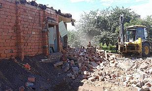 Демонтаж зданий и снос сооружений