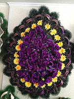 Венок траурный ритуальный из искуственных цветов и ткани