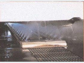 Автоматическая мойка днища спецтехники качающимися форсунками