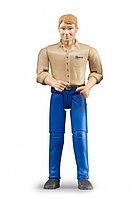 Фигурка мужчины в синих штанах и бежевой рубашке Bruder