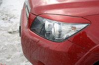 Накладки на фары (реснички) Toyota RAV 4 06-10