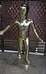 Манекен детский глянцевый золотистый бегущий