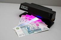 Денежный аппарат для проверки подлинности денежных купюр
