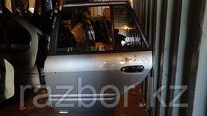 Дверь левая задняя Mazda Capella/626
