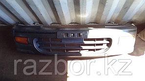 Передний бампер Nissan Serena