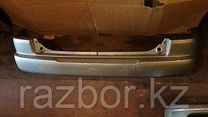 Бампер задний Mazda Demio