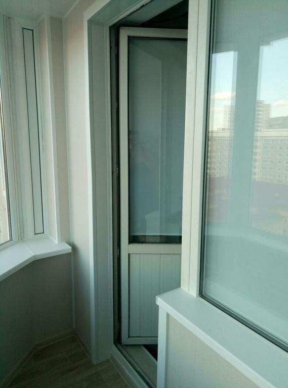 Обшивка балкона декоративной панелью Сауран 14