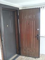 Утеплённая дверь штампованная с мдф