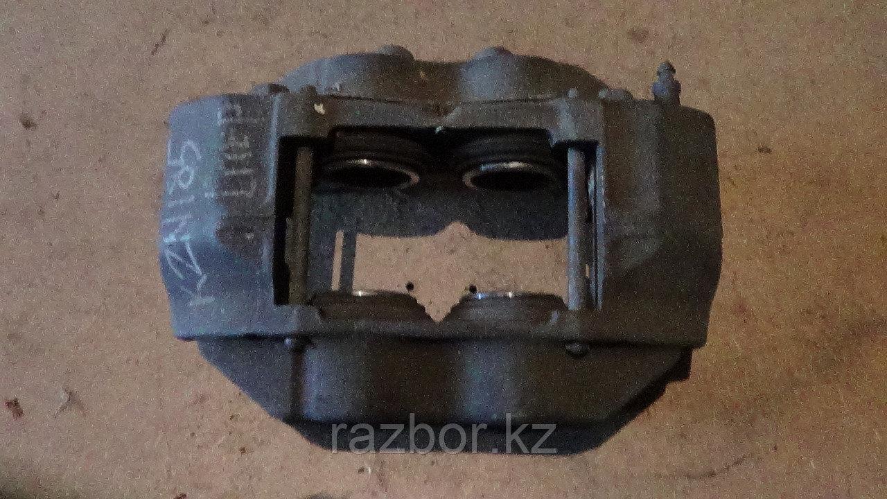 Тормозной суппорт левый передний Toyota Hilux Surf (KZN185)