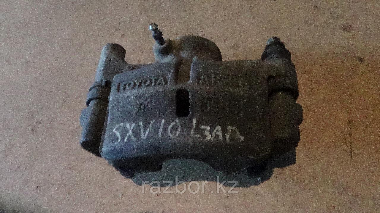 Тормозной суппорт левый задний Toyota Scepter