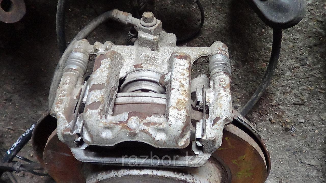 Тормозной суппорт Chevrolet Cruze левый задний