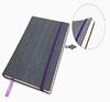 Блокнот серого цвета с фиолетовой окантовкой на обложке