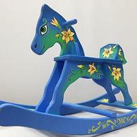 Деревянные лошадки качалки