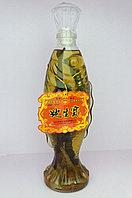 Китайская настойка со змеей и корнем женьшеня.