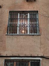 Решетки на окна с элементами ковки