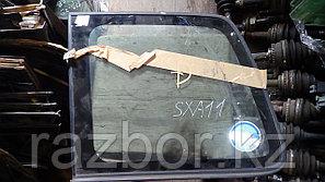 Стекло заднее левое (собачатник) Toyota RAV4 (SXA11)