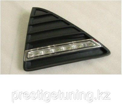 Рамки в бампер с ходовыми огнями LED DRL на Ford Focus